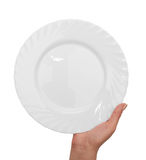 Plate with hand Stock Images