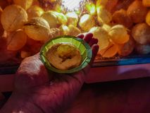 Plate in hand containing panipuri fuchka golgappa. Indian snack chaat spicy food royalty free stock photography