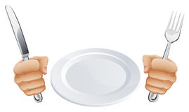Plate and hands holding cutlery Stock Photos