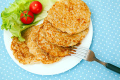 A plate of hash browns Stock Photos
