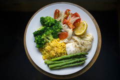 Plate of healthy food. Cod fish with rice and vegetables Stock Images