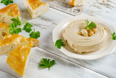 Plate of a Healthy Homemade Creamy Hummus with pita. Stock Photo