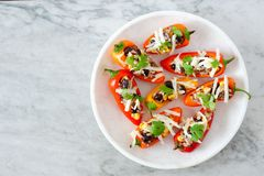 Plate of healthy stuffed mini peppers on a light background Stock Photos