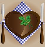 Plate-heart, a knife and fork Royalty Free Stock Images