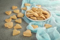 Plate with heart shaped butter cookies Royalty Free Stock Image
