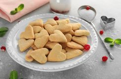 Plate with heart shaped butter cookies Stock Images