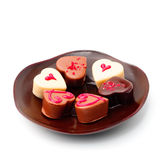 Plate of heart-shaped chocolates Royalty Free Stock Photos