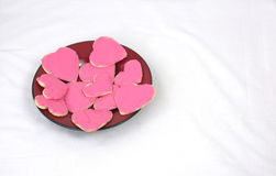 Plate of heart shaped cookies with pink frosting Royalty Free Stock Photo