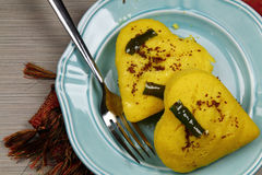 A plate of heart shaped lentil dhokla Stock Photos