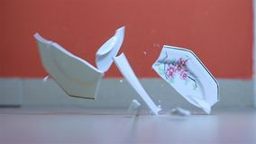 Plate hitting the ground. Plate shattering, slow motion from 120 FPS capture stock footage