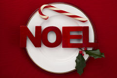 Plate with holiday themes. On red Stock Photography