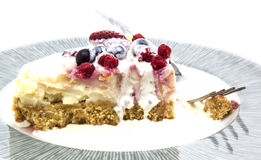 Plate of home made strawberry and fresh berry cheesecake Stock Images