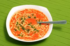 Plate of home-made tomato soup with noodles stock photography