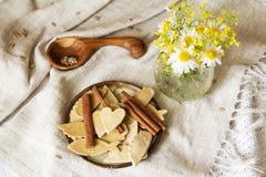 Plate of homemade cookies. And cinnamon. Cookies handmade. Dry diet cookies, healthy lifestyle Royalty Free Stock Images