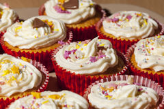 Plate of homemade cupcakes topped in buttercream and sprinkles Stock Images