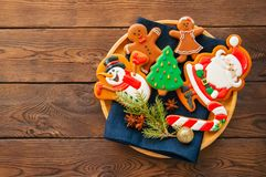 Plate with homemade glazed different shapes of christmas cookies royalty free stock photography