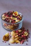 Plate of homemade muesli with cornflakes, freeze dried strawberry, walnuts, chocolate balls, pumpkin seeds Stock Photos