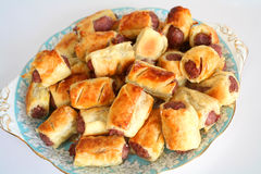 Plate of homemade sausage rolls stock photos