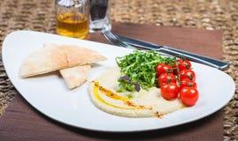 Plate with hummus dip and tapas Stock Photos