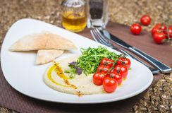 Plate with hummus dip and tapas Royalty Free Stock Photos