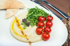 Plate with hummus dip and tapas Royalty Free Stock Image