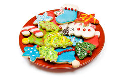 Plate of iced Christmas cookies  on white. A plate of homemade iced, sugar, cut out Christmas cookies  on white Royalty Free Stock Photography