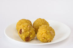 Plate with Indian sweet - Boondi Laddoo. Plate with Boondi Laddoo (Indian sweet) on a white background stock photography
