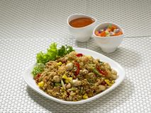 Plate of Indonesian Fried Rice. Mixed with vegetables and seafood, side view Royalty Free Stock Images