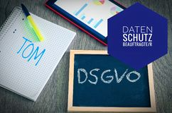 Plate with the inscription DSGVO Datenschutzgrundverordnung and TOM in English GDPR General Data Protection Regulation with a stock photography