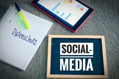Plate with the inscription Social Media and in german Datenschutz in english Privacy with a tablet and blockto to symbolize the da. Ta scandal stock photography