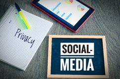 Plate with the inscription Social Media and Privacy with a tablet and blockto to symbolize the data scandal.  royalty free stock image