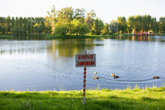 The plate with the inscription - swimming is forbidden. Stock Photo