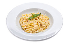 Plate of a italian pasta with grated parmesan cheese and basil l Stock Photos