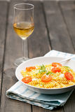 Plate of Italian Pasta and Wine on Wooden Table Royalty Free Stock Image
