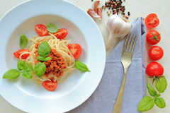 Plate with italian spaghetti with fresh basil Stock Image