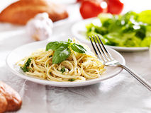 Plate of italian spaghetti with pesto sauce Stock Images