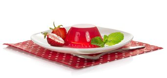 Plate with jelly, slices of strawberry and mint Stock Photography