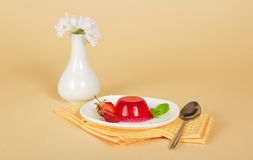 Plate with jelly and spoon on napkin Stock Photography