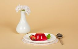 Plate with jelly, spoon, napkin and vase Royalty Free Stock Images