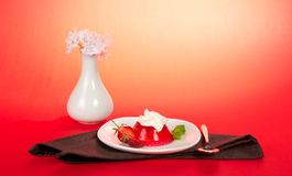 Plate with jelly and whipped cream Royalty Free Stock Image