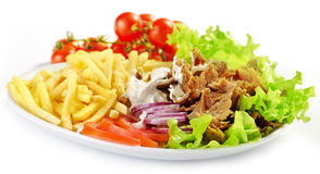 Plate of kebab and vegetables Stock Photography