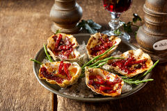 Plate of Kilpatrick Oysters on Wood Table Stock Photos