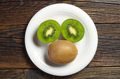 Plate with kiwi fruit Stock Photo