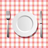 Plate, knife and fork. Table arrangement with a plate, a fork and a knife Stock Photos