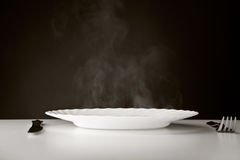 Plate, knife and fork Royalty Free Stock Image