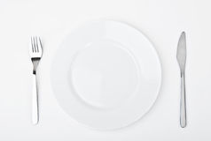 Plate, knife and fork Royalty Free Stock Images
