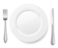 Plate with knife and fork. On white Stock Images