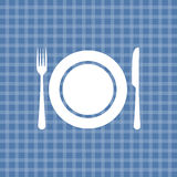 Plate knife and fork on blue tablecloth Royalty Free Stock Photography