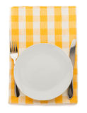 Plate, knife and fork  at cutting board Royalty Free Stock Photo