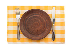 Plate, knife and fork at cutting board royalty free stock photography